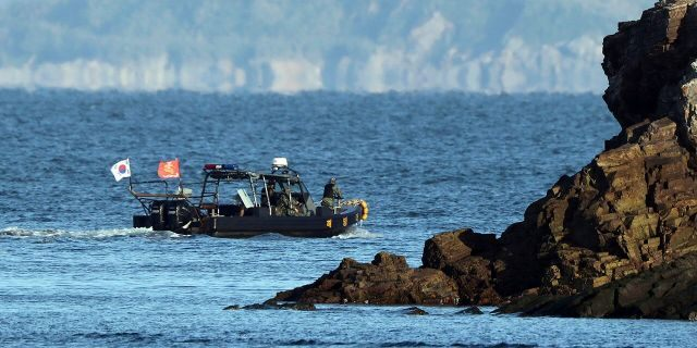A South Korean marine boat patrols near Yeonpyeong island, South Korea, on Sunday.  (Baek Seung-ryul/Yonhap via AP)