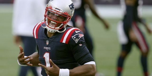 New England Patriots quarterback Cam Newton celebrates after defeating the Las Vegas Raiders in an NFL football game, Sunday, Sept. 27, 2020, in Foxborough, Mass. (AP Photo/Charles Krupa)