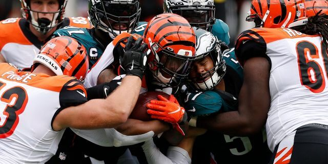 Cincinnati Bengals' Joe Mixon (28) is tackled by Philadelphia Eagles' Fletcher Cox (91) and T.J. Edwards (57) during the second half of an NFL football game, Sunday, Sept. 27, 2020, in Philadelphia. (AP Photo/Laurence Kesterson)