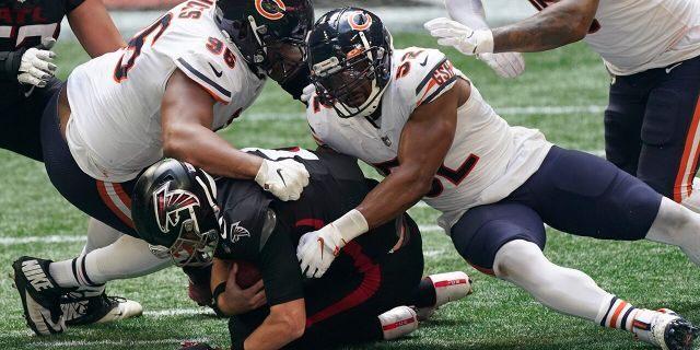 Chicago Bears outside linebacker Khalil Mack (52) and Chicago Bears defensive tackle Akiem Hicks (96) sack Atlanta Falcons quarterback Matt Ryan (2) during the second half of an NFL football game, Sunday, Sept. 27, 2020, in Atlanta. (AP Photo/John Bazemore)