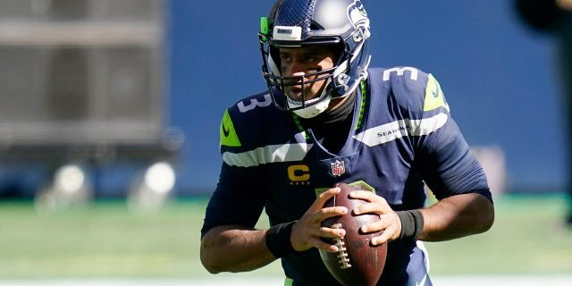 Seattle Seahawks quarterback Russell Wilson drops to pass against the Dallas Cowboys during the first half of an NFL football game, Sunday, Sept. 27, 2020, in Seattle. (AP Photo/Elaine Thompson)