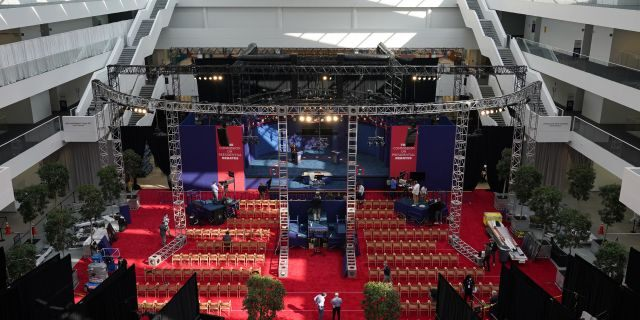 Preparations take place for the first presidential debate in the Sheila and Eric Samson Pavilion, Monday, Sept. 28, 2020, in Cleveland. The first debate between President Donald Trump and Democratic presidential candidate, former Vice President Joe Biden is scheduled to take place Tuesday, Sept. 29. (AP Photo/Patrick Semansky)