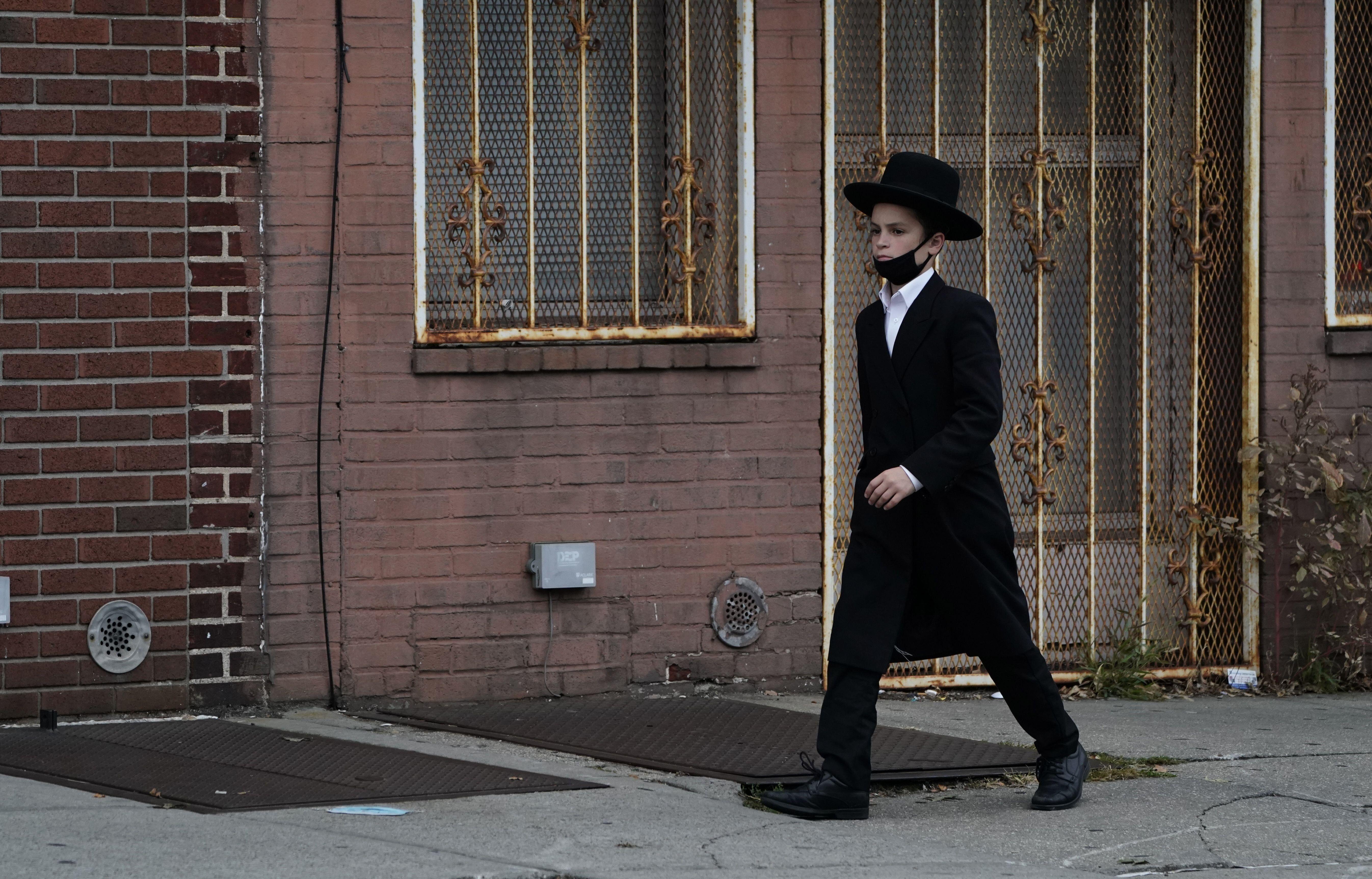 An Orthodox Jewish boy walks through his Brooklyn neighborhood on September 29, 2020, in New York.