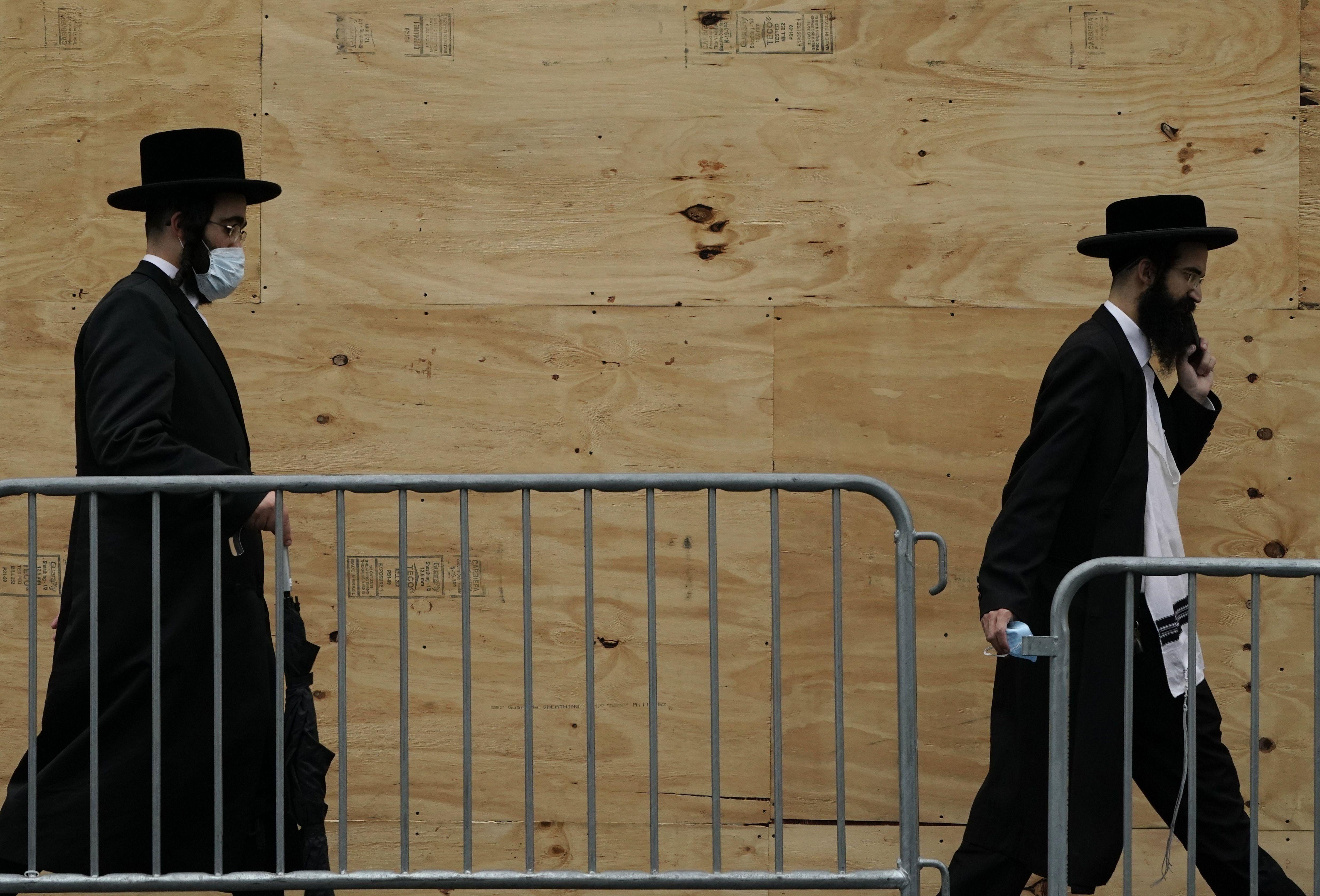 Orthodox Jewish men walk through a Brooklyn neighborhood on September 29, 2020, in New York.