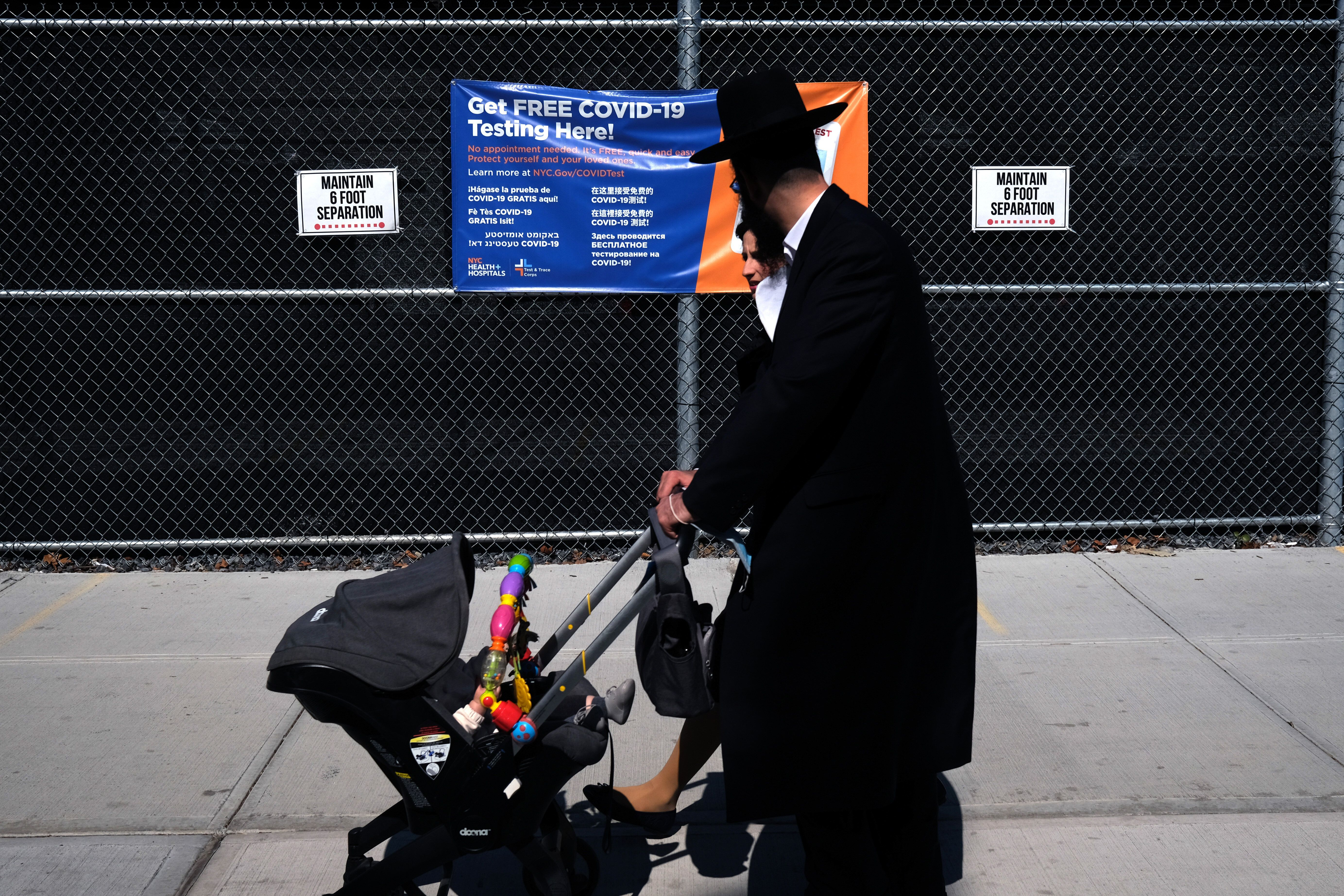 Residents walk by a COVID-19 testing site in the Brooklyn neighborhood of Borough Park on September 23, 2020 in New York City