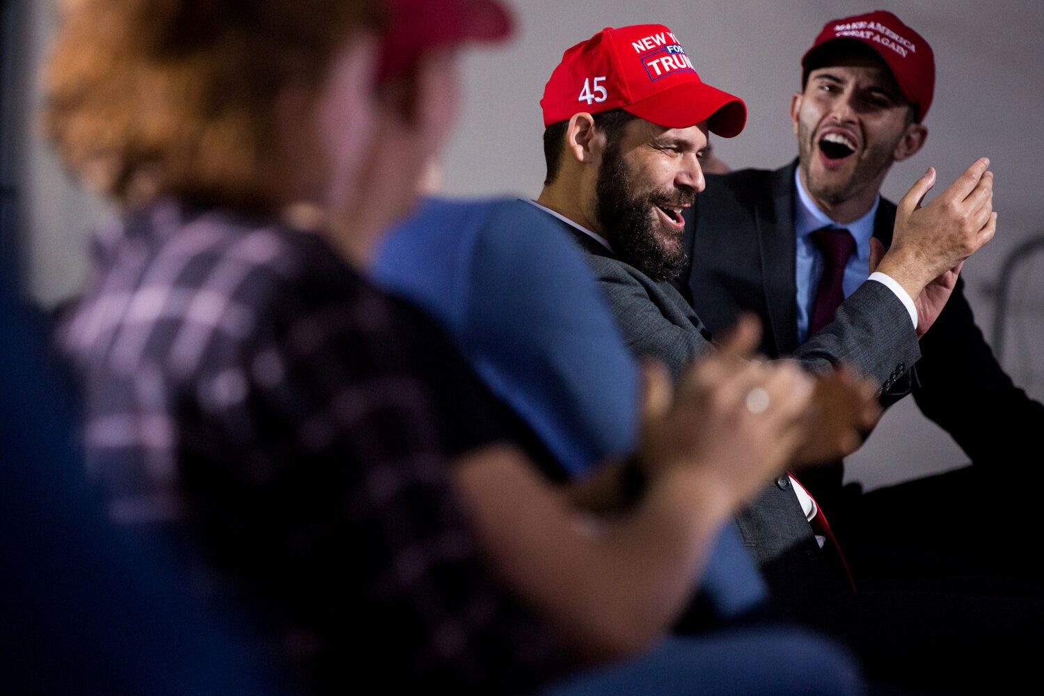 Mike Gee, center, applauds for the president while watching the debate stream in Lititz.