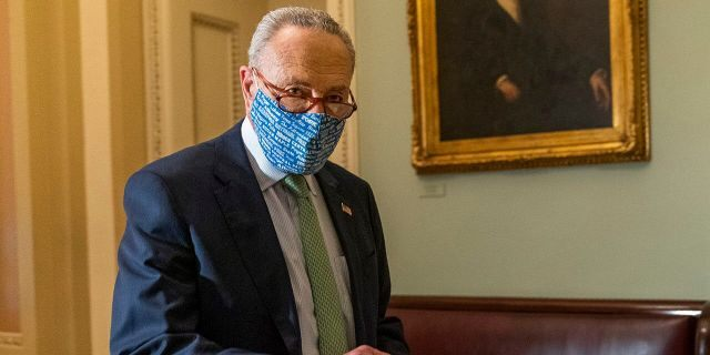 Senate Minority Leader Chuck Schumer of N.Y. walks outside the Senate floor on Capitol Hill, Thursday, Oct. 1, 2020, in Washington. (Associated Press)