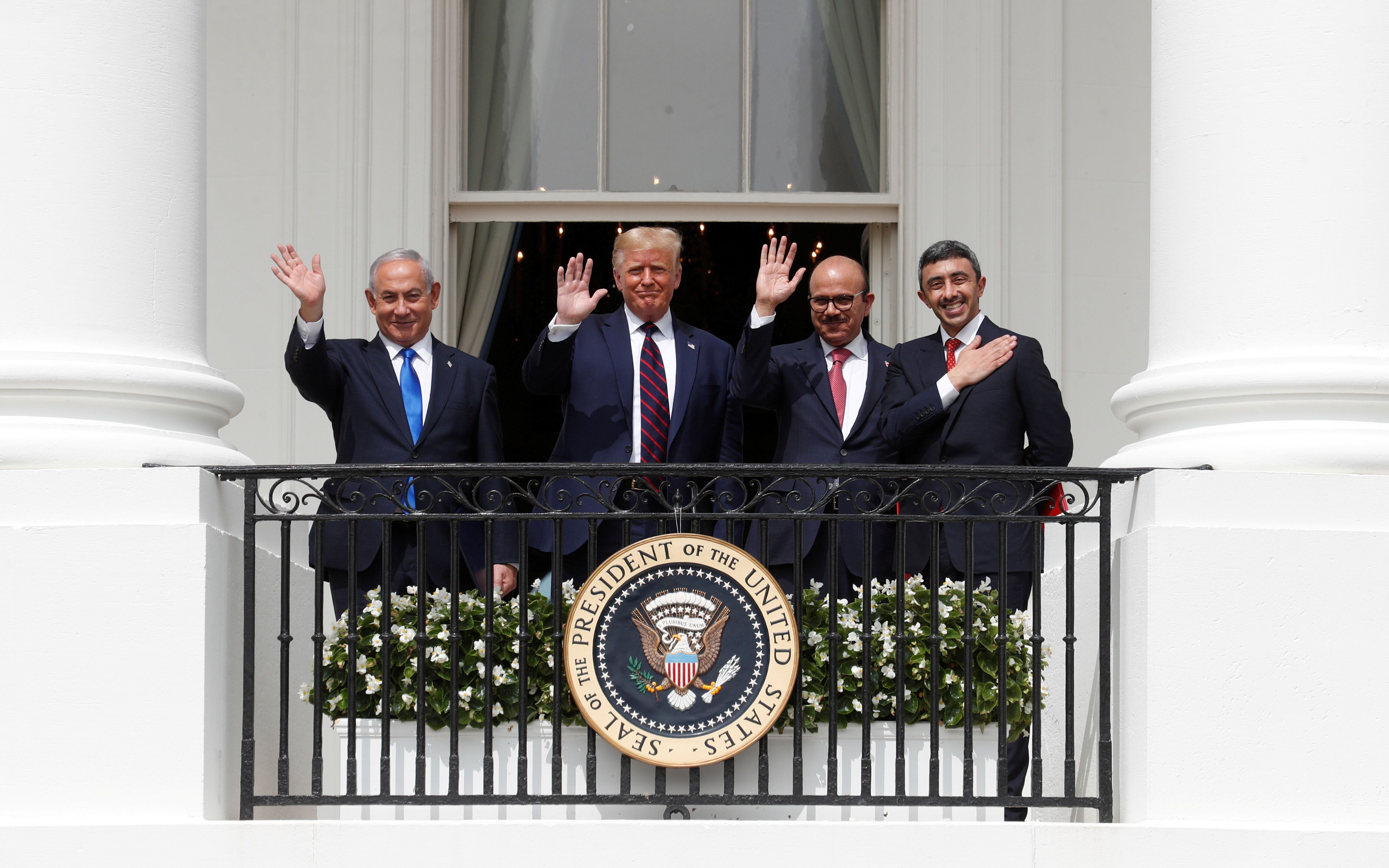 Israel's Prime Minister Benjamin Netanyahu, U.S. President Donald Trump, Bahrain's Foreign Minister Abdullatif Al Zayani and