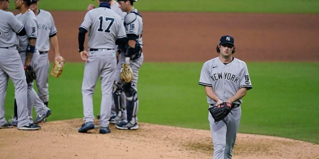 New York Yankees' Gerrit Cole walks to the dugout after being removed during the sixth inning in Game 5 of the baseball team's AL Division Series against the Tampa Bay Rays, Friday, Oct. 9, 2020, in San Diego. (Associated Press)