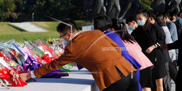 People visit the Mansu Hill to lay flowers to the bronze statues of former North Korean leaders Kim Il Sung and Kim Jong Il in Pyongyang, North Korea, Saturday, Oct. 10, 2020, on the occasion of the 75th founding anniversary of the country's Workers' Party. (AP Photo/Jon Chol Jin)