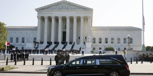 The flag-draped casket of Justice Ruth Bader Ginsburg arrives at the Supreme Court in Washington, Wednesday, Sept. 23, 2020. Ginsburg, 87, died of cancer on Sept. 18. (AP Photo/Patrick Semansky)