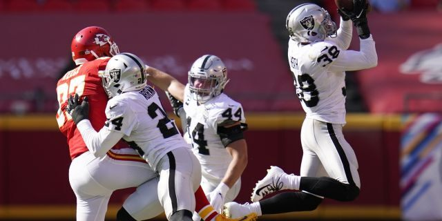 Las Vegas Raiders safety Jeff Heath (38) intercepts a pass intended for Kansas City Chiefs tight end Travis Kelce (87) during the second half of an NFL football game, Sunday, Oct. 11, 2020, in Kansas City. (AP Photo/Jeff Roberson)