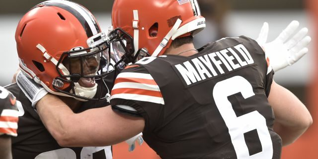 Cleveland Browns wide receiver Rashard Higgins (82) and quarterback Baker Mayfield celebrate after a 15-yard touchdown by Higgins during the first half of an NFL football game against the Indianapolis Colts, Sunday, Oct. 11, 2020, in Cleveland. (AP Photo/David Richard)