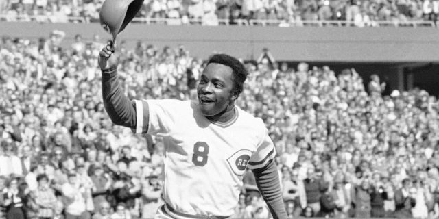 FILE - In this Saturday, Oct. 16, 1976, file photo, Cincinnati second baseman Joe Morgan tips his helmet to the fans as he rounds the bases after a homer in the first inning against the New York Yankees at Riverfront Stadium in Cincinnati. Hall of Fame second baseman Joe Morgan has died. A family spokesman says he died at his home Sunday, Oct. 11, 2020, in Danville, Calif. (AP Photo/File)