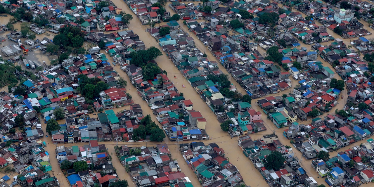 In this photo provided by the Malacanang Presidential Photographers Division, floodwaters bought by Typhoon Vamco inundate Metro Manila, Philippines, Thursday, Nov. 12, 2020.