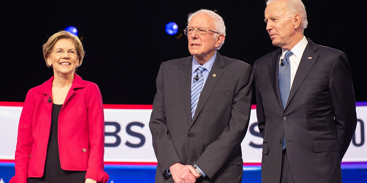 2020 presidential candidates Senator Elizabeth Warren, a Democrat from Massachusetts, left, Senator Bernie Sanders, an Independent from Vermont, and former Vice President Joe Biden, arrive on stage ahead of the Democratic presidential debate in Charleston, South Carolina, U.S., on Tuesday, Feb. 25, 2020. Michael Bloomberg is trying for a do-over in Tuesdays Democratic presidential debate, previewing that hell turn his focus to newly minted front-runner Bernie Sanders after a much-criticized debut at last weeks face-off. Photographer: Alice Keeney/Bloomberg via Getty Images