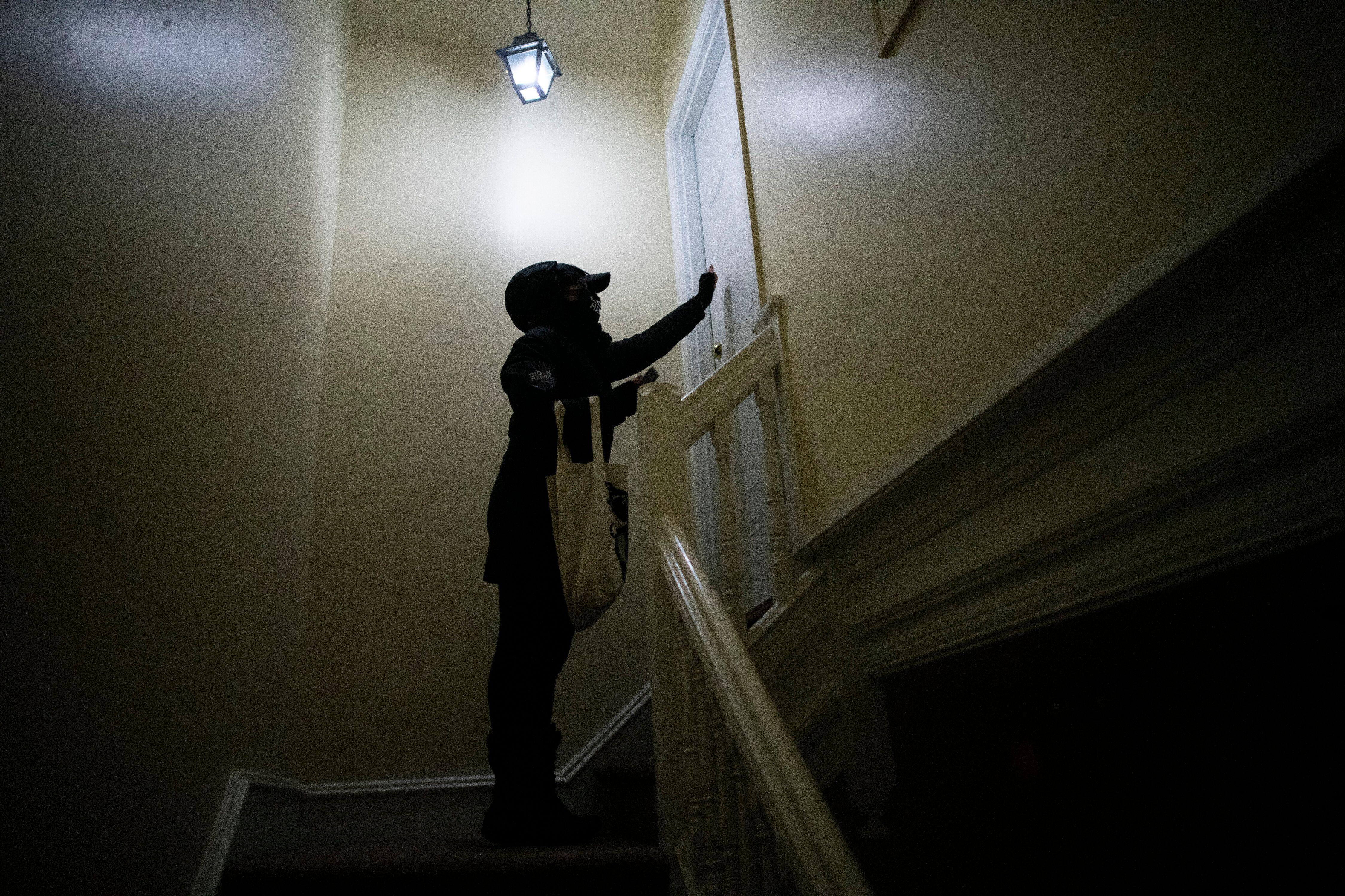 A volunteer knocks on doors for Joe Biden in Landsdowne, Pennsylvania. Critics believe that the party adopted traditional fie