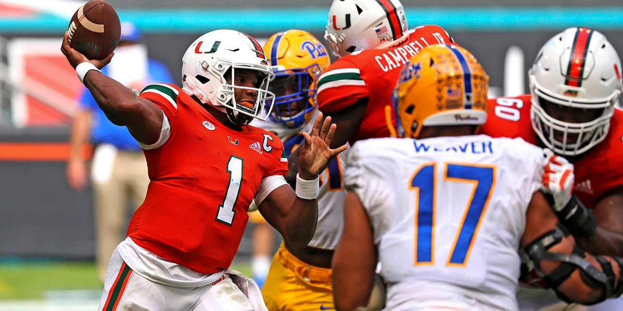 Miami quarterback D'Eriq King (1) passes against Pitt in the second half of an NCAA college football game in Miami Gardens, Fla., Saturday, Oct. 17, 2020. (Al Diaz/Miami Herald via AP)