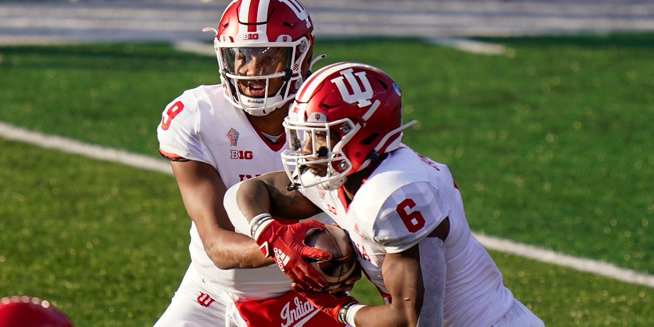 Indiana quarterback Michael Penix Jr. (9) hands off to running back Sampson James (6) during the second quarter of the team's NCAA college football game against Rutgers, Saturday, Oct. 31, 2020, in Piscataway, N.J. (AP Photo/Corey Sipkin)