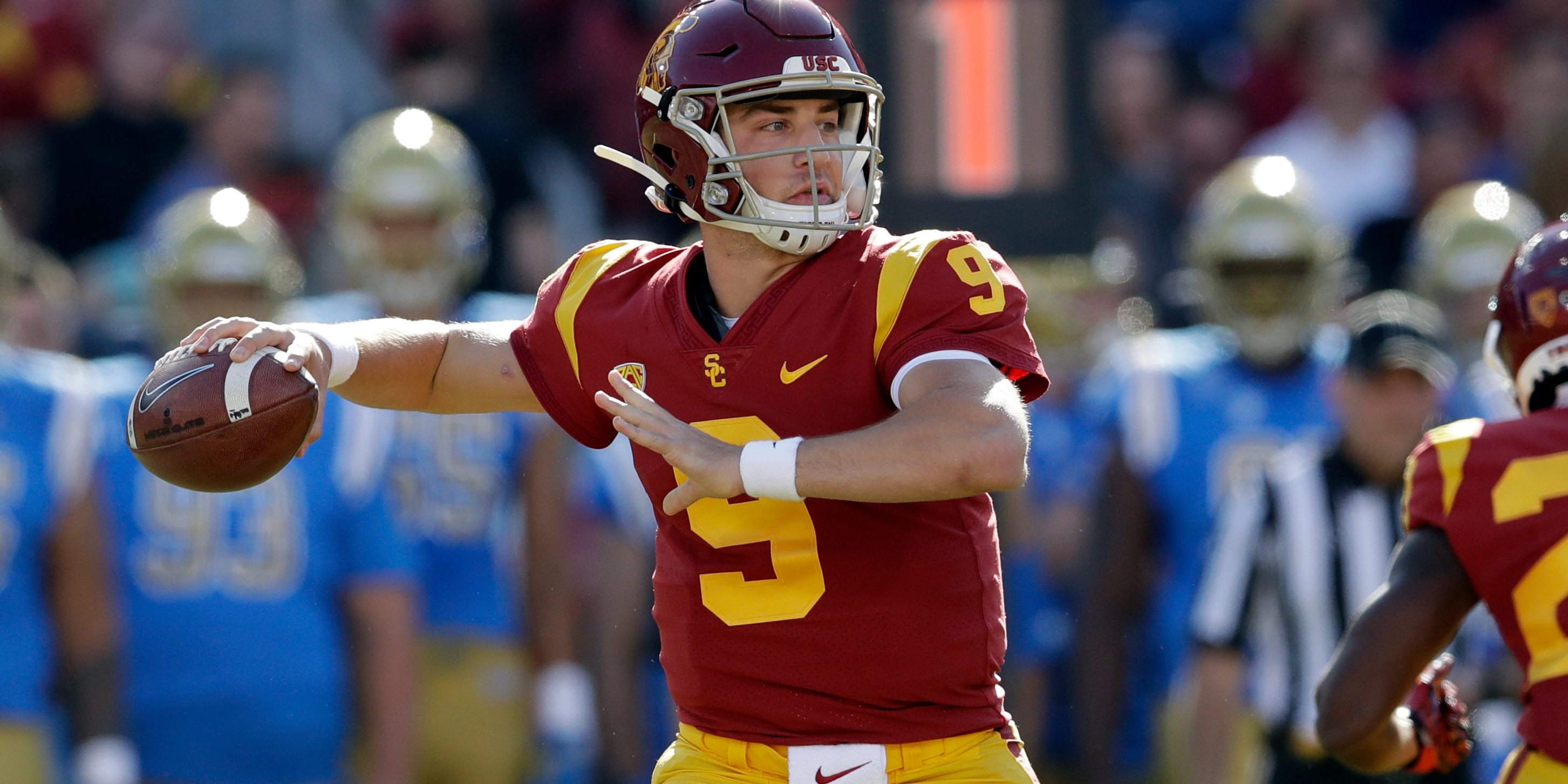In this Nov. 23, 2019, file photo, Southern California quarterback Kedon Slovis throws against UCLA during the first half of an NCAA college football game in Los Angeles. (AP Photo/Marcio Jose Sanchez, File)