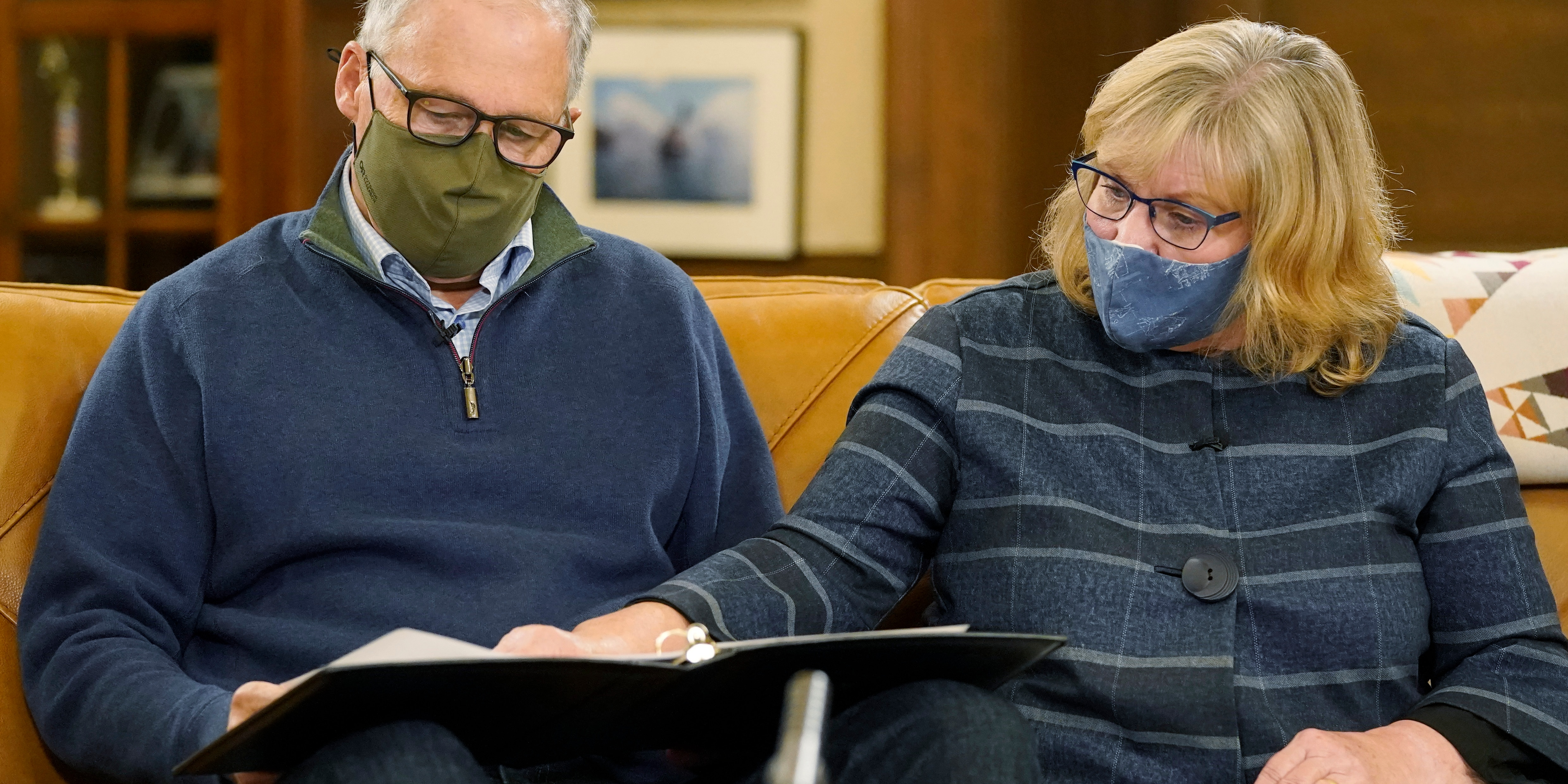 Washington Gov. Jay Inslee and his wife, Trudi, wear masks as they work on their speech before taking them off for a final rehearsal in the governor's office before making a statewide televised address on COVID-19, Nov. 12, 2020, at the Capitol in Olympia, Wash. (Associated Press)