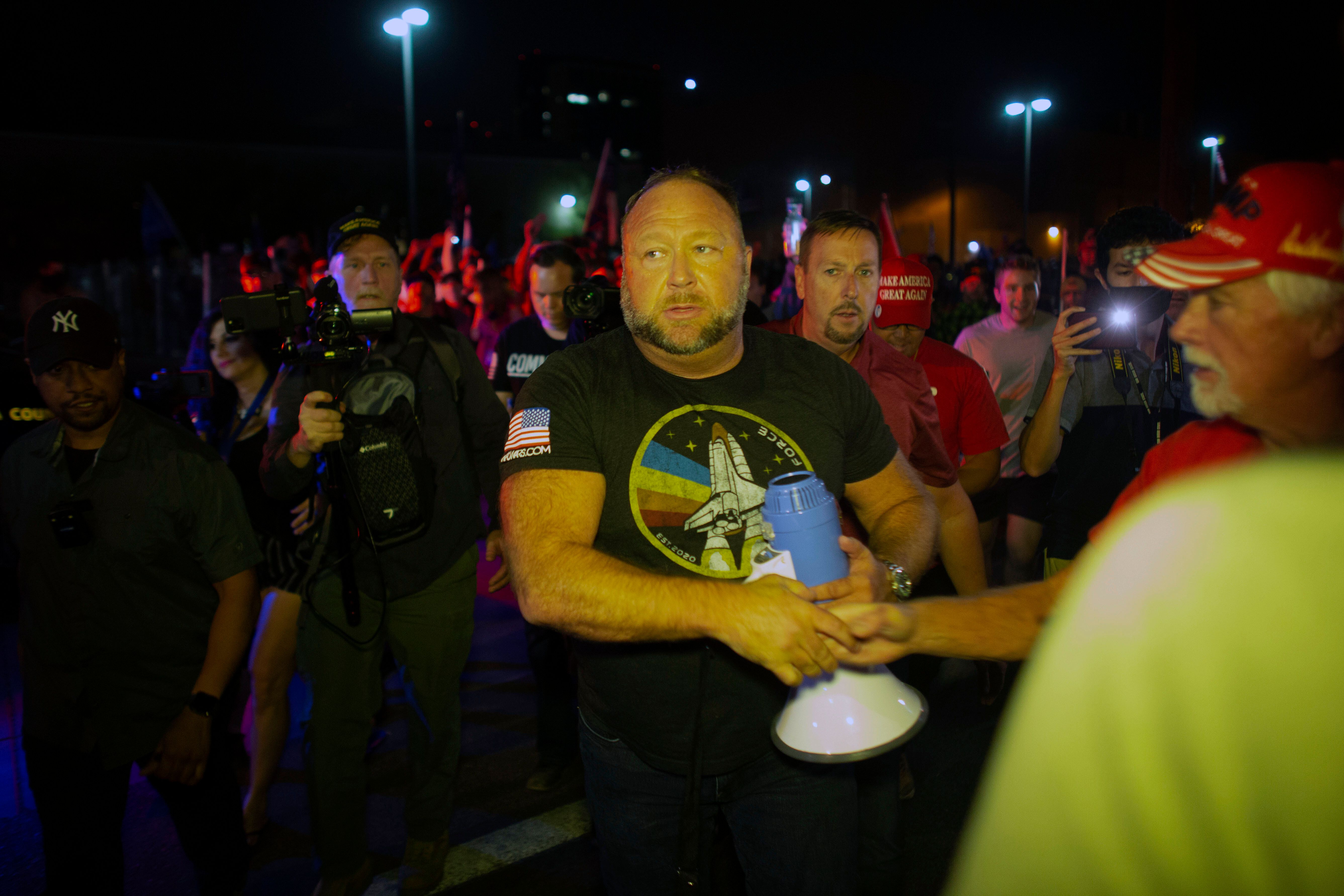 After making a violent speech outside the elections center on Thursday night, far-right radio host Alex Jones returned the ne