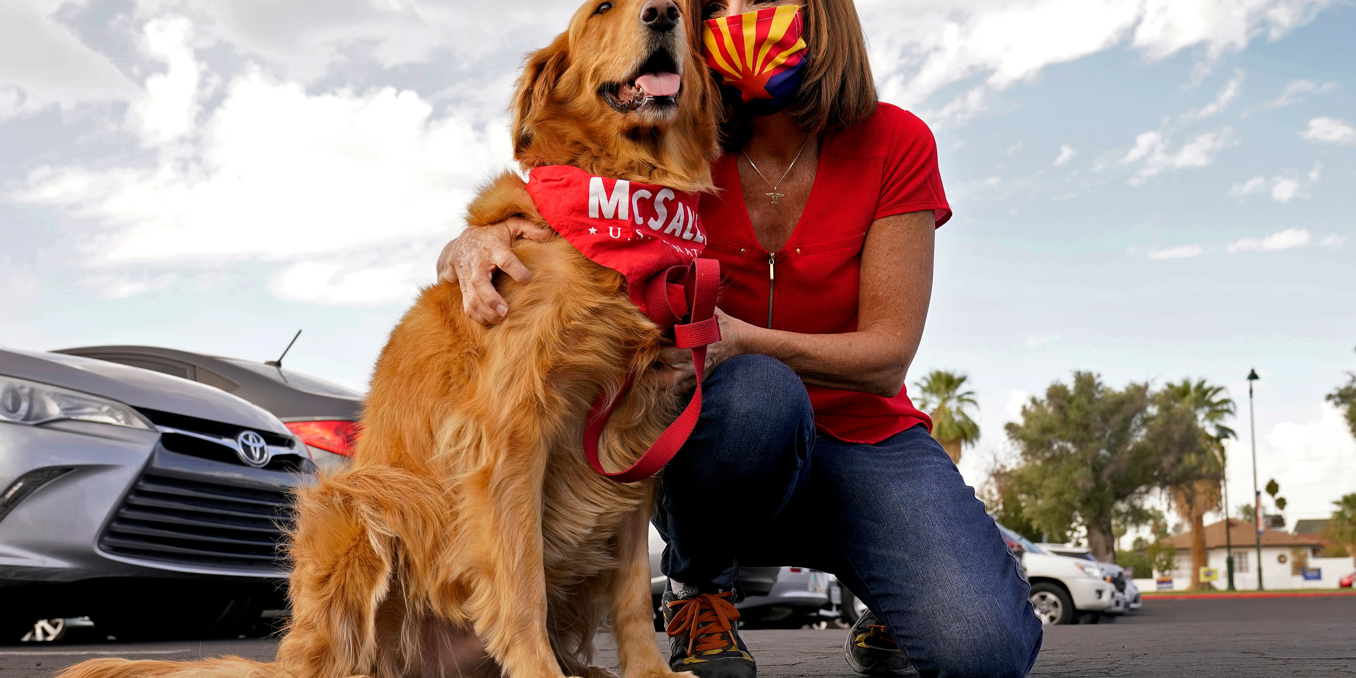 U.S. Sen. Martha McSally, R-Ariz., hugs her dog Boomer prior to greeting voters at a polling station, Tuesday, Nov. 3, 2020, in Mesa, Ariz. (AP Photo/Matt York)