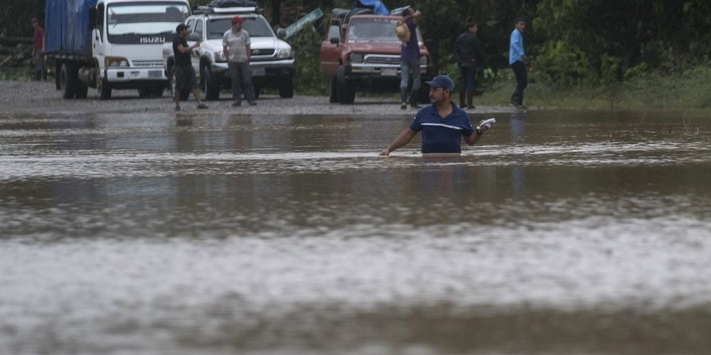 A man walks through a flooded road in Okonwas, Nicaragua, Wednesday, Nov. 4, 2020. Eta weakened from the Category 4 hurricane to a tropical storm after lashing Nicaragua's Caribbean coast for much of Tuesday, its floodwaters isolating already remote communities and setting off deadly landslides. (AP Photo/Carlos Herrera)