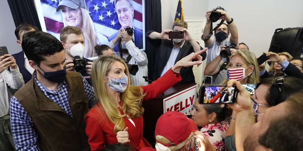 In this Nov. 11, 2020 photo, Republican candidate for U.S. Senate Sen. Kelly Loeffler gestures to supporters after speaking at a campaign rally in Marietta, Ga. Republicans are flooding Georgia with cash and field operatives as they look to keep Democrats from seizing control of the Senate under President-elect Joe Biden's administration. The Republican National Committee says it is funding more than 600 staffers in the state with an investment of at least $20 million ahead of the Jan. 5 runoffs for the seats held by GOP Sens. Kelly Loeffler and David Perdue. (AP Photo/John Bazemore)