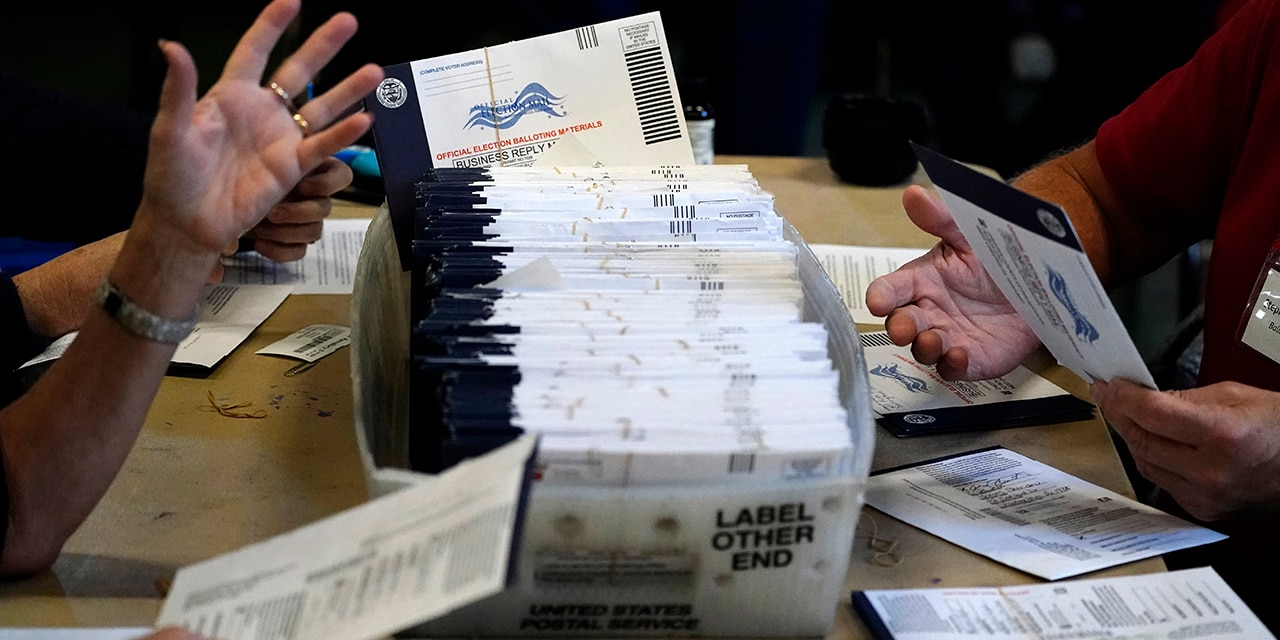 Chester County election workers process mail-in and absentee ballots for the 2020 general election in the United States at West Chester University, Wednesday, Nov. 4, 2020. (AP Photo/Matt Slocum)
