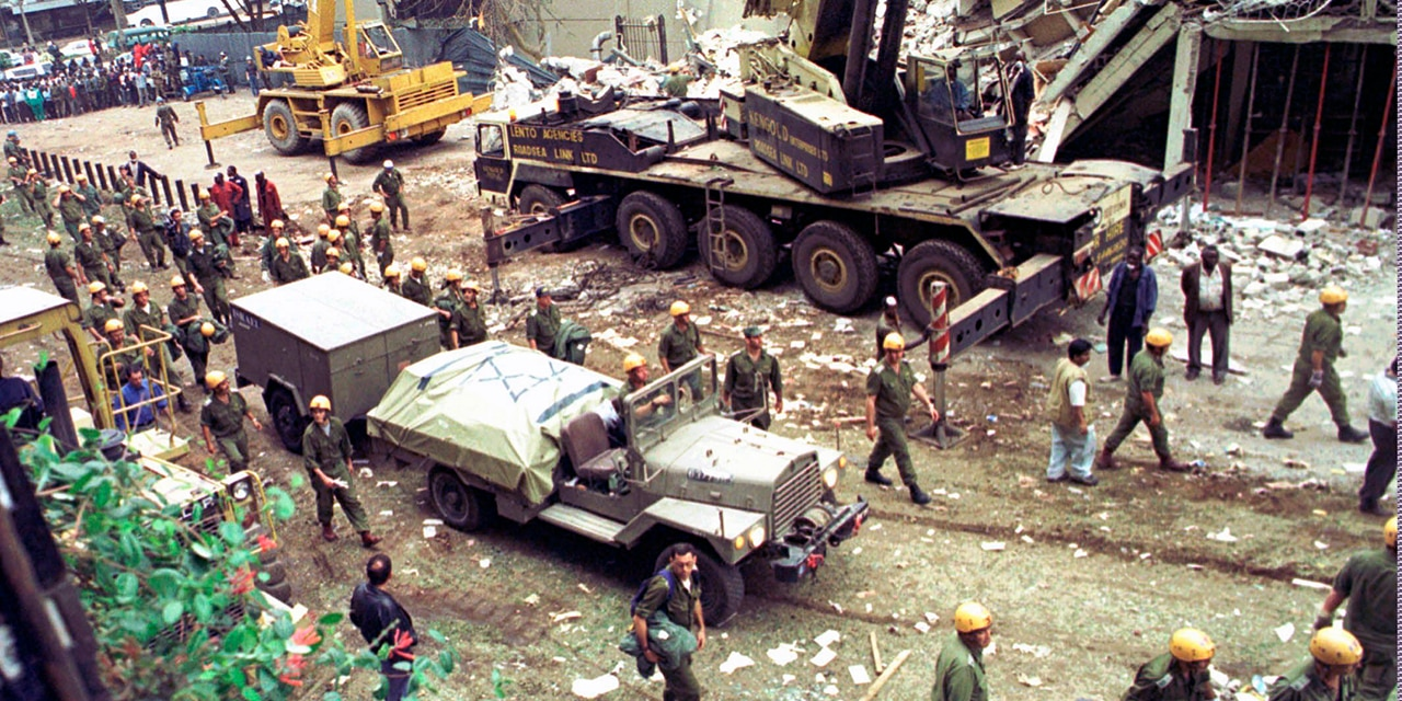 Israeli soldiers bring in heavy lifting equipment to the wreckage of the Ufundi House, adjacent to the U.S. Embassy in Nairobi on Aug. 9, 1998. The United States and Israel worked together to track and kill Abu Mohammed al-Masri, a senior Al Qaeda operative in Iran earlier this year, a bold intelligence operation by the two allied nations that came as the Trump administration was ramping up pressure on Tehran. (AP Photo/Sayyid Azim, File)