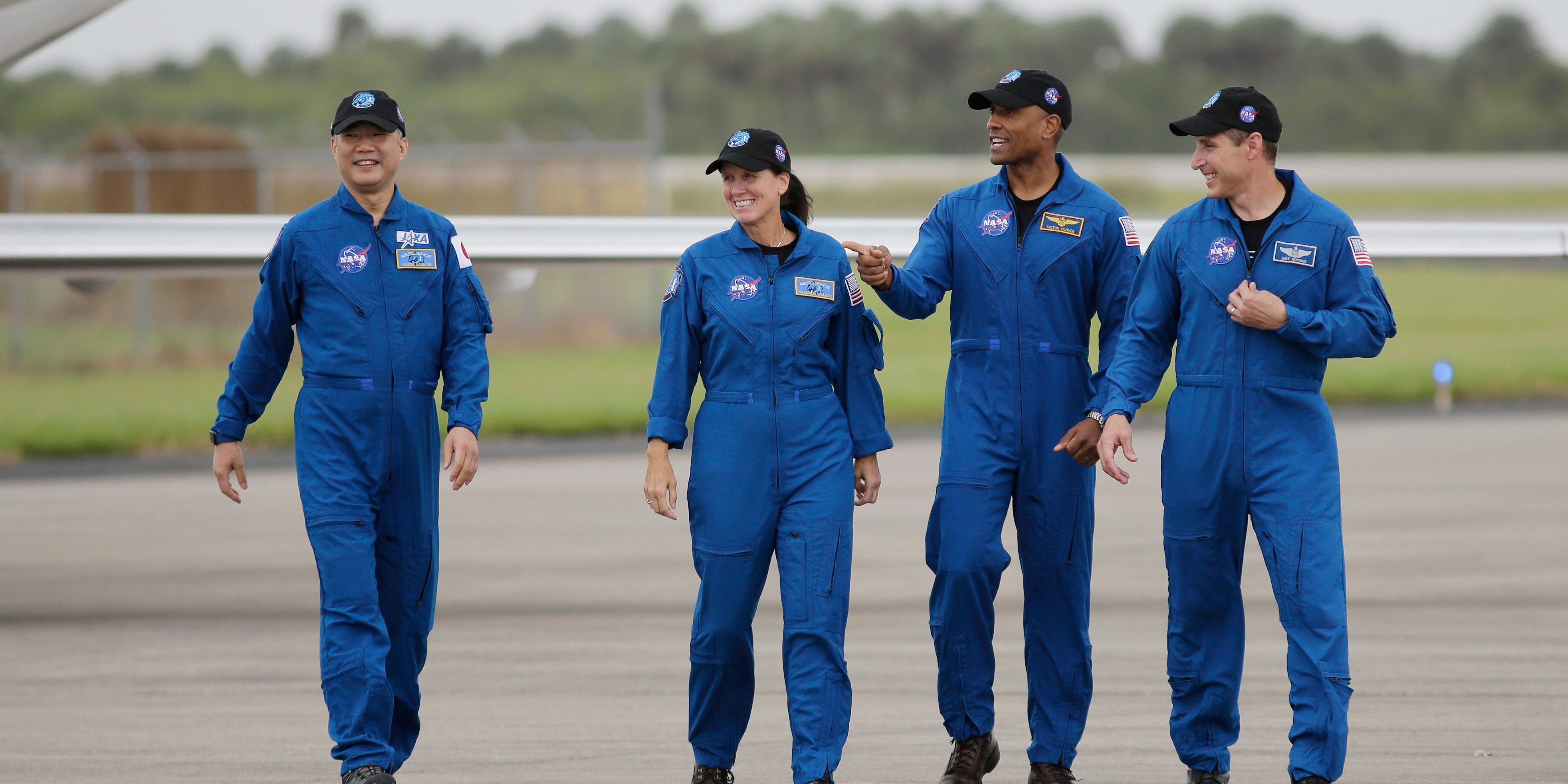 Astronaut Soichi Noguchi, of Japan, from left, NASA Astronauts Shannon Walker, Victor Glover and Michael Hopkins walk after arriving at Kennedy Space Center, Sunday, Nov. 8, 2020, in Cape Canaveral, Fla.