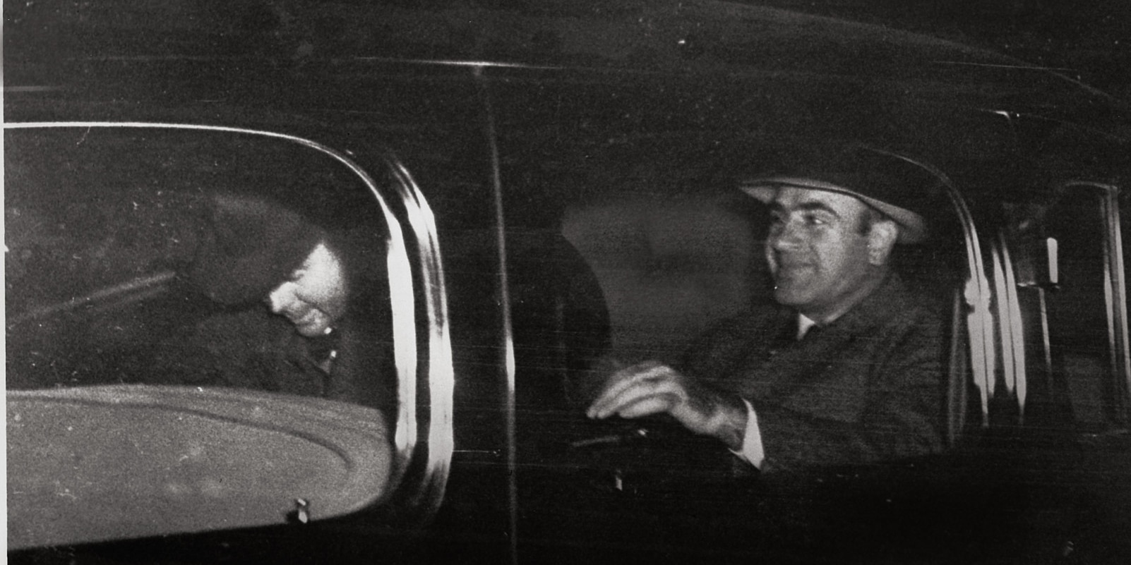 Al Capone, right, Chicago's infamous gang overlord during prohibition, leaves Harrisburg, Pa., on Nov. 16, 1939 with a federal officer for Lewisburg, Pa., where he was released after spending seven years in prison in Atlanta and San Francisco's Alcatraz. (AP Photo)