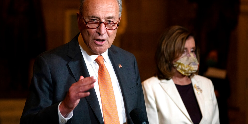FILE: Senate Minority Leader Sen. Chuck Schumer of N.Y., speaks to reporters as House Speaker Nancy Pelosi of Calif., listens at right on Capitol Hill in Washington.