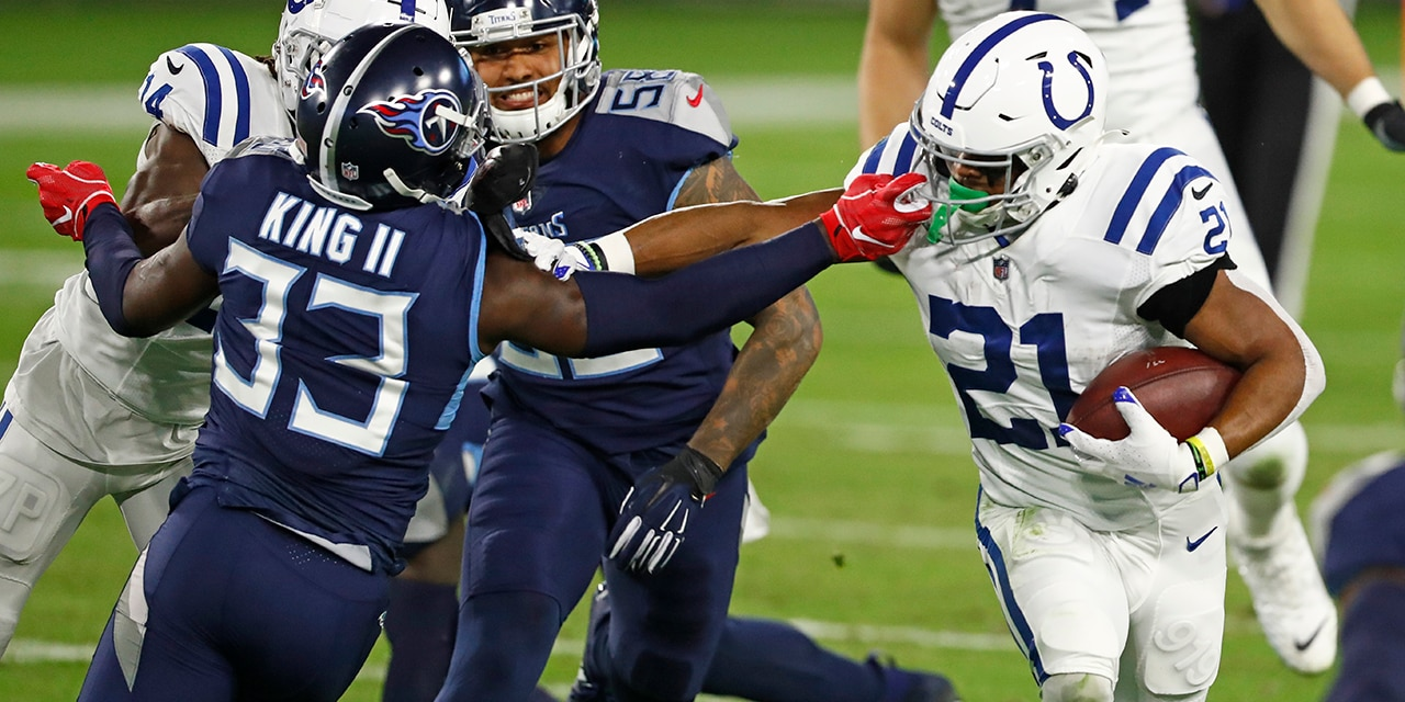 Tennessee Titans cornerback Desmond King (33) reaches for Indianapolis Colts running back Nyheim Hines (21) in the first half of an NFL football game Thursday, Nov. 12, 2020, in Nashville, Tenn. (AP Photo/Wade Payne)