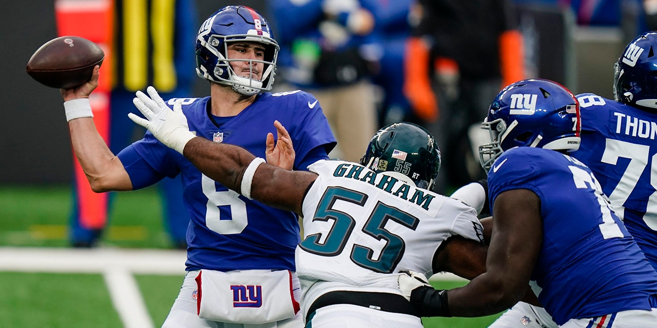 New York Giants quarterback Daniel Jones (8) looks to throw a pass as Philadelphia Eagles' Brandon Graham (55) rushes him during the first half of an NFL football game Sunday, Nov. 15, 2020, in East Rutherford, N.J. (AP Photo/Seth Wenig)