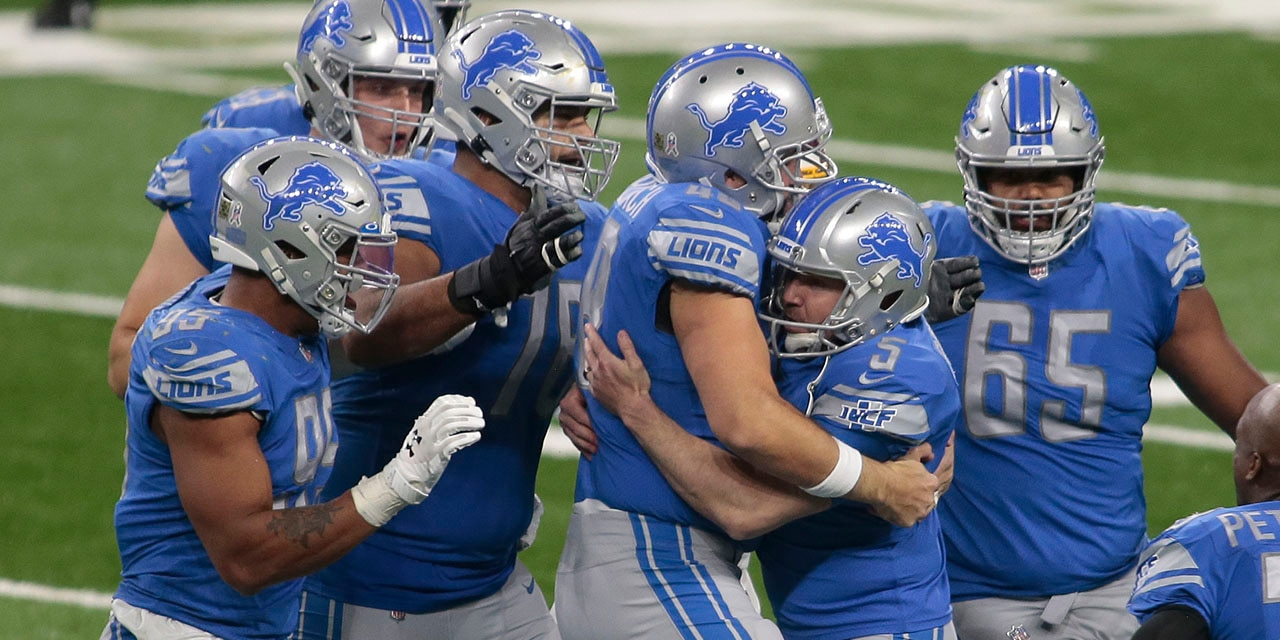 Detroit Lions teammates surround kicker Matt Prater (5) after his winning field goal in the closing seconds during the second half of an NFL football game against the Washington Football Team, Sunday, Nov. 15, 2020, in Detroit. (AP Photo/Tony Ding)