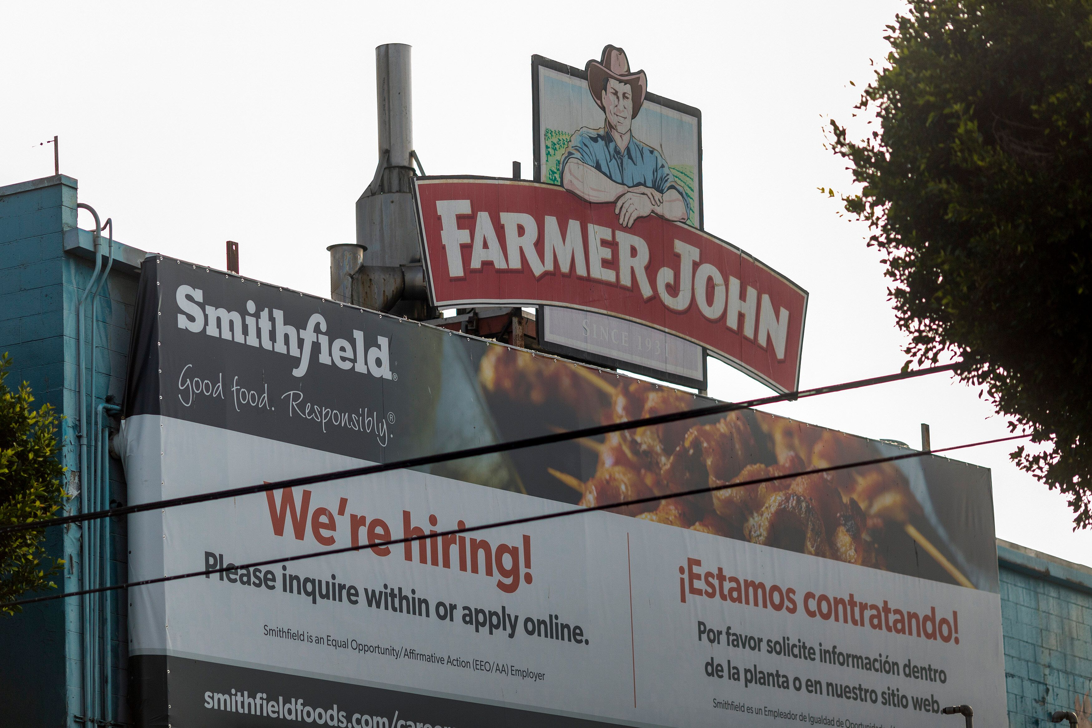 A sign on the Farmer John slaughterhouse in Vernon advertises job openings in May after more than 150 workers tested positive