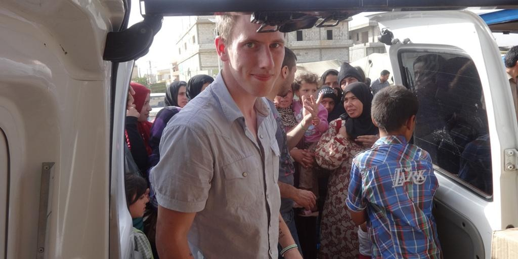 This undated photo provided by the Kassig family shows Peter Kassig delivering supplies for Syrian refugees.