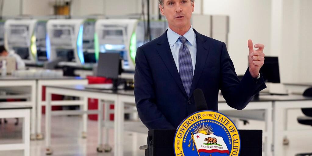 FILE: California Gov. Gavin Newsom speaks at a COVID-19 testing facility in Valencia, Calif.