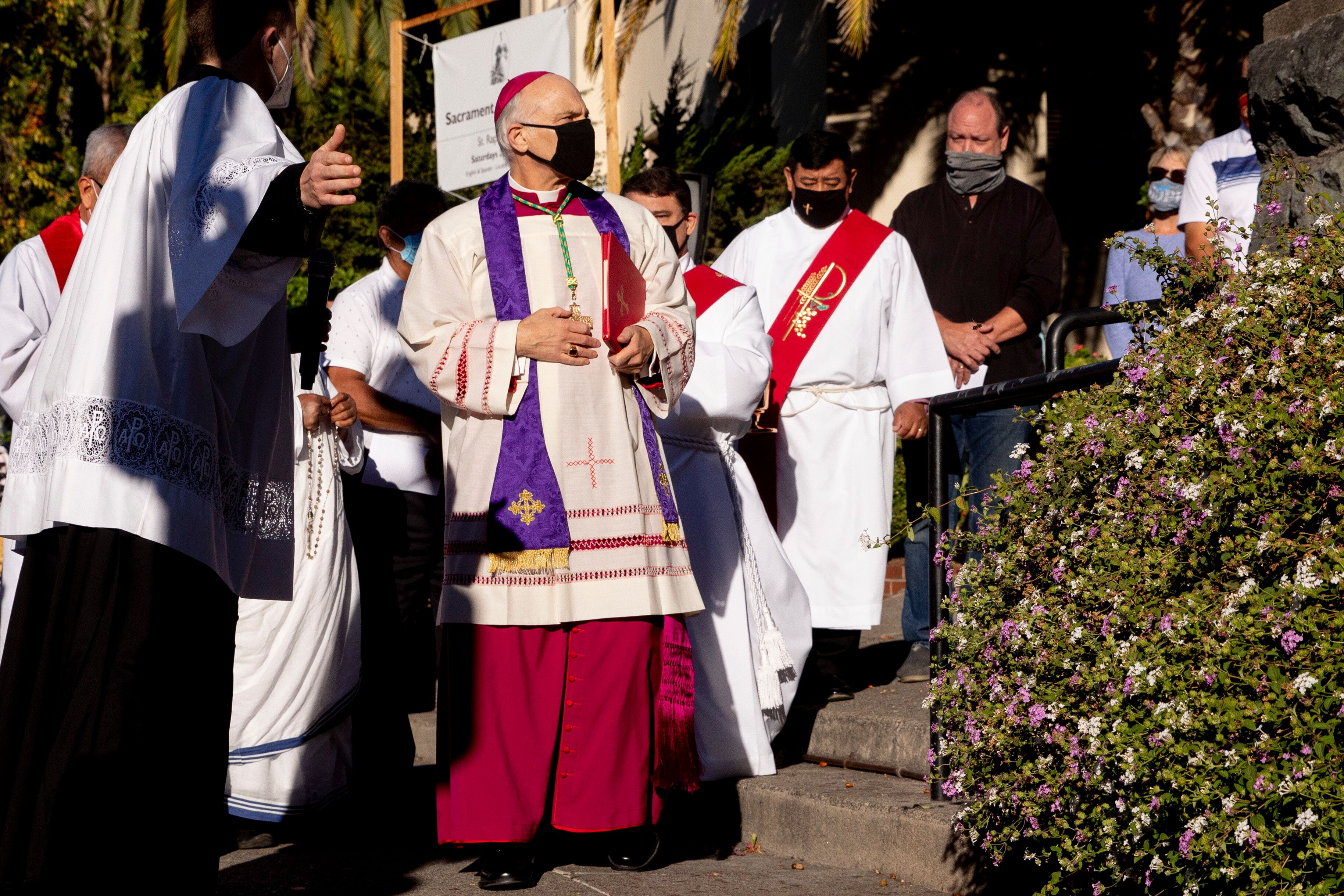 Archbishop Salvatore Cordileone (center) arrives to conduct an exorcism in San Rafael, California, on Oct. 17, 2020, on the s