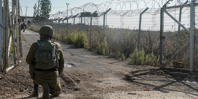 Israeli soldier monitors the area near Israel's border with Syria. (Israel Defense Forces)