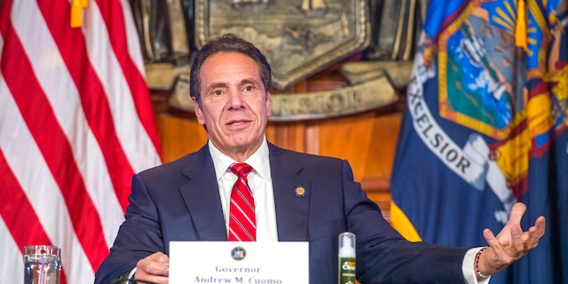 In this Nov. 18, photo provided by the Office of Governor Andrew M. Cuomo, Gov. Cuomo holds a press briefing on the coronavirus in the Red Room at the State Capitol in Albany, N.Y.