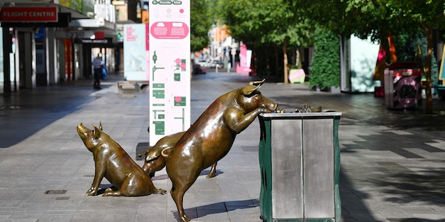 Sculptures of pigs are displayed in a nearly empty pedestrian mall in Adelaide, Australia, Thursday, Nov. 19, 2020. (David Mariuz/AAP Image via AP)