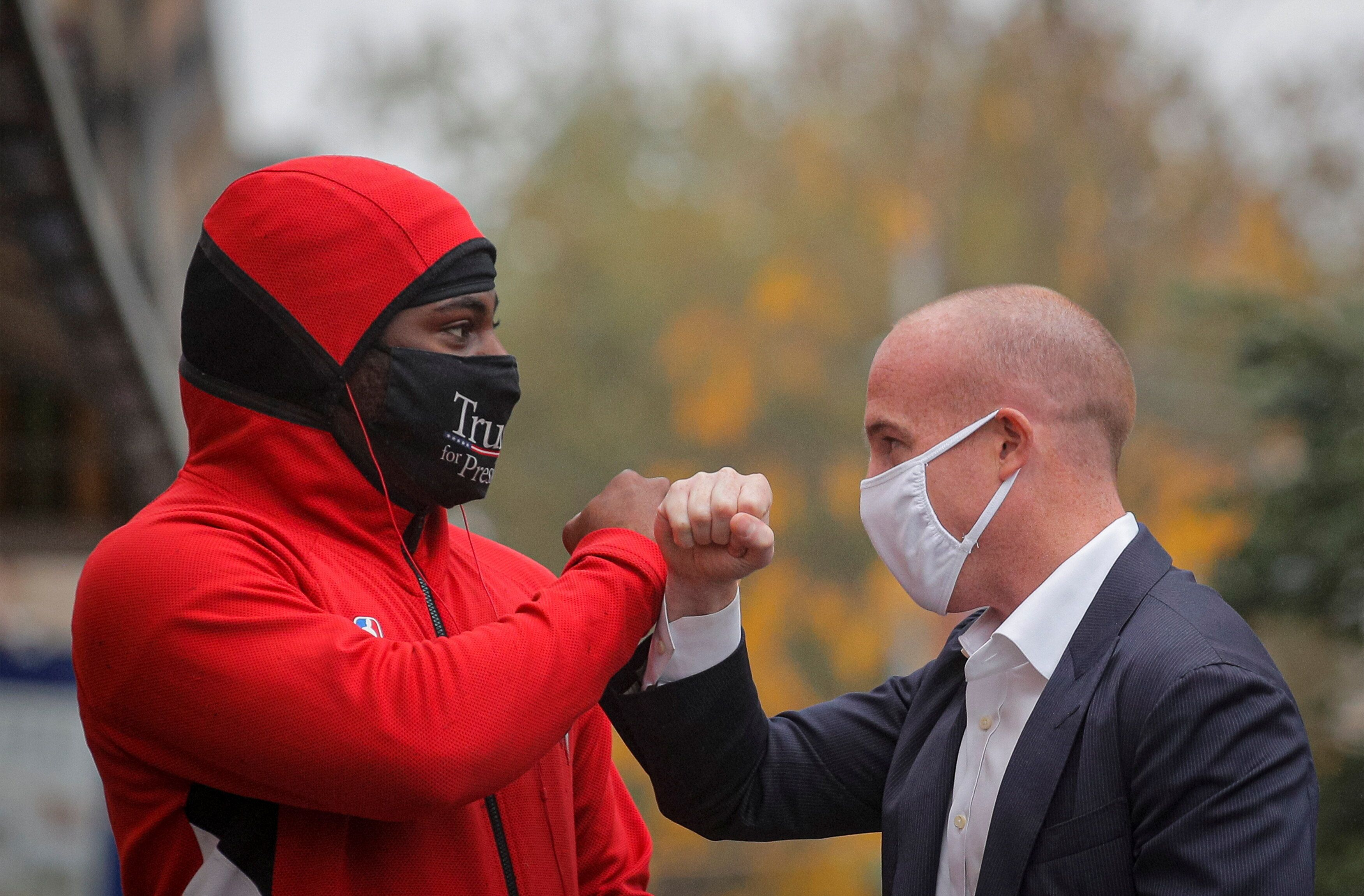 Rep. Max Rose (D-N.Y.), shown here greeting a supporter of President Donald Trump while on the campaign trail last month, rep