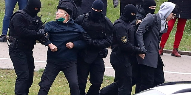 Belarusian riot police detain demonstrators during an opposition rally to protest the official presidential election results in Minsk, Belarus, Sunday, Nov. 15, 2020. (AP Photo)