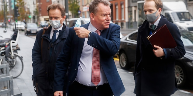 Britain's chief negotiator David Frost, center, removes his face mask to talk to the media as he arrives for Brexit talks with EU chief negotiator Michel Barnier in Brussels, Monday, Nov. 16, 2020. Britain and the EU say any post-Brexit trade deal must be agreed upon by mid-November so it can be ratified by the end of the year, but the negotiations remain stuck on key issues like fishing rights and competition rules. (AP Photo/Francisco Seco)