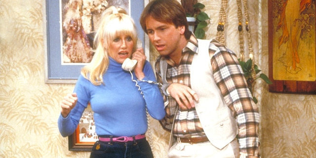 "Suzanne Somers and John Ritter in an episode of ""Three's Company."" (Getty Images)"