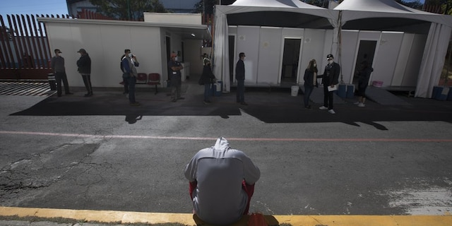 <br> A young man waits to be tested for COVID-19 outside the Ajusco Medio General Hospital in Mexico City, Thursday, Nov. 19, 2020. (AP Photo/Marco Ugarte)