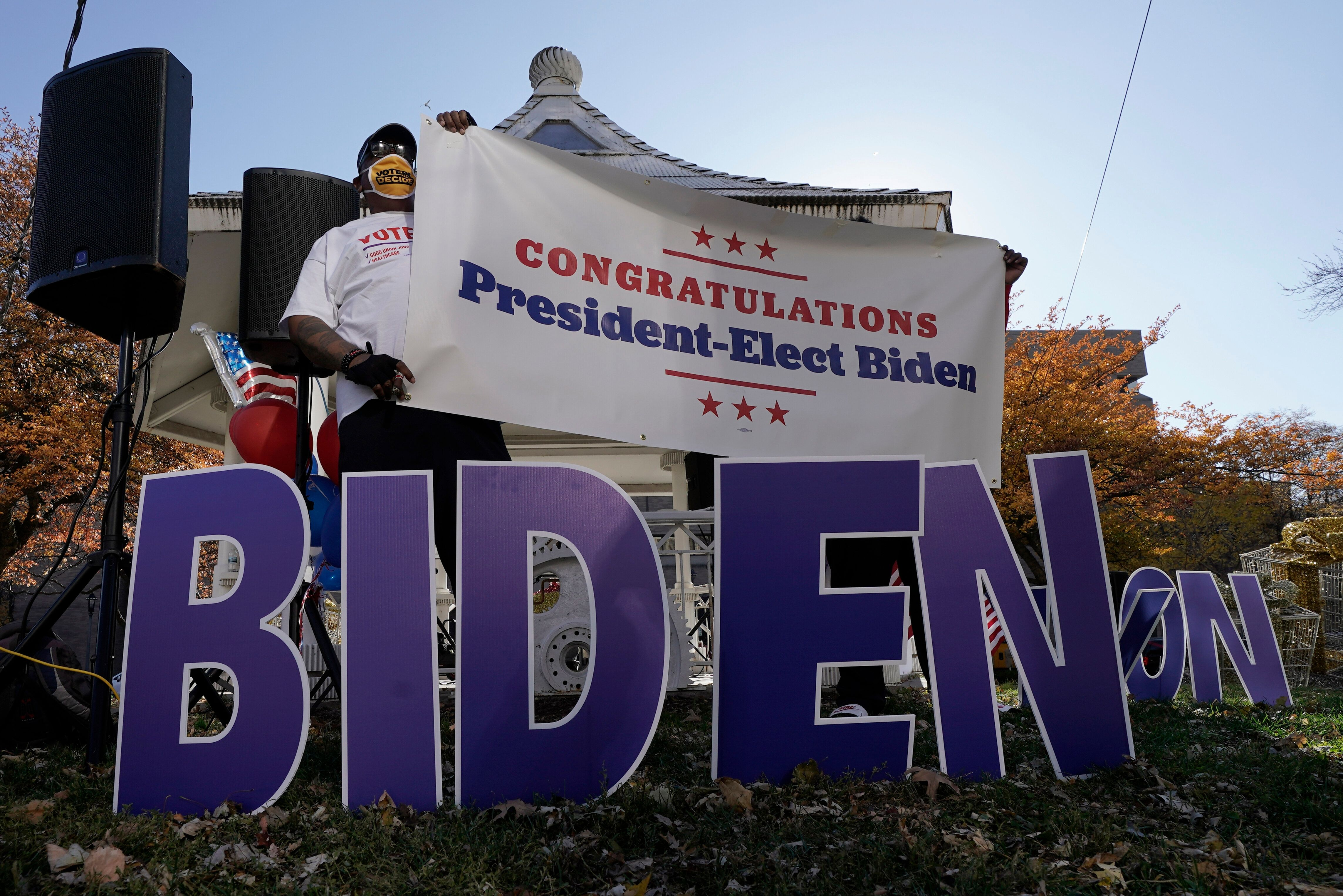 Joe Biden supporters in Milwaukee react to the announcement on Nov. 7 that Biden defeated Trump in the presidential election.